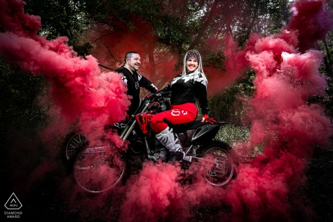 Minneapolis, MN portrait e-session with the adventure Couple on their dirt-bikes with smoke bombs behind them