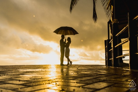 Maceió, Brazil environmental engagement e-session showing the sun, umbrella and a Silhouette of a couple