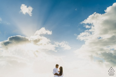 Maceió, Brazil portrait e-session under the clouds showing that Love is to throw oneself into the immensity