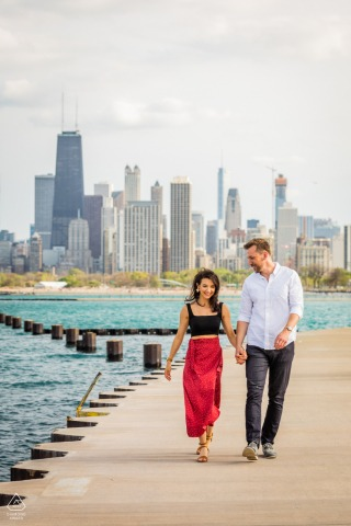 Fullerton Beach in Chicago, IL on-location portrait e-shoot with an Engaged couple walking along Chicago's lakefront
