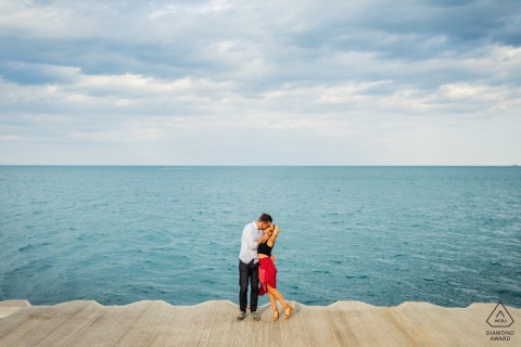 Fullerton Beach in Chicago, IL portrait e-session for a Couple kissing in front of Lake Michigan