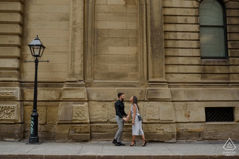 Old Montreal, Canada environmental engagement e-session with the couple holding hands in the city