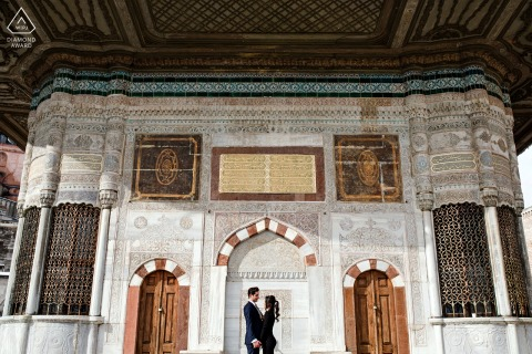 Istanbul, Turkey environmental engagement e-session with a couple framed in the doorway of a large building