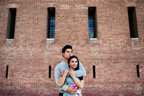 San Francisco on-location portrait e-shoot for a couple Embracing lovingly by the fort
