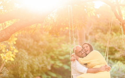 Maceió, Alagoas portrait e-session with a man and woman at a country house, sitting on a swing and smiling