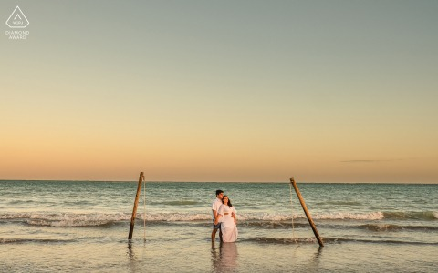 Maceió, Alagoas environmental engagement e-session showing the Man and woman are together and holding each other on the beach at sunset