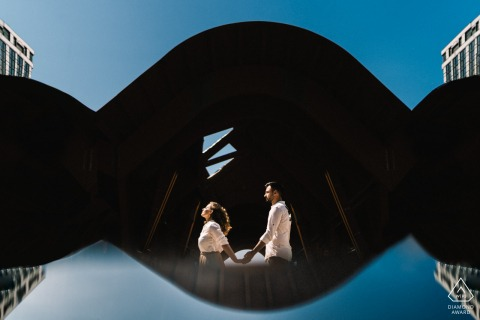 True Love pre wedding Photoshoot in Napoli of a couple caught in blue and black reflections of sky love