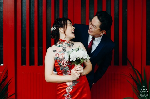 True Love Engagement Posed Portrait in Singapore capturing a couple in formal, red attire with flowers