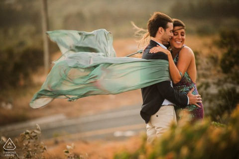 True Love pre wedding Photoshoot at El Valle in Panama of a couple hugging in a wind gust
