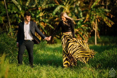 True Love Engagement Picture Session in Panama City showing a couple Walking holding hands in the jungle