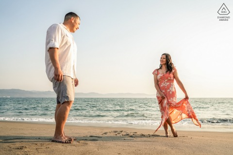 True Love Pre-Wedding Portrait Session at the Marriott Resort Puerto Vallarta in Mexico illustrating a couple having a carefree stroll on the sands of the beach