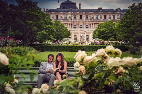 True Love Pre-Wedding Portrait Session at the Garden of Palais Royal in Paris capturing a couple reading books in France