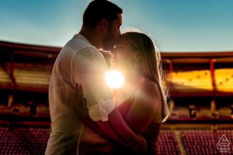 True Love Pre-Wedding Portrait Session at the Plaza de Toros de Córdoba capturing a Spain couple at the stadium at sunset