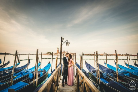 True Love Engagement Portrait Session in Venice displaying a Veneto couple posing at the docks surrounded by boats