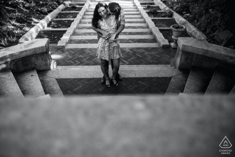 True Love Pre-Wedding Portrait Session at the Spanish Steps in Washington DC showing a couple standing on the top of the steps