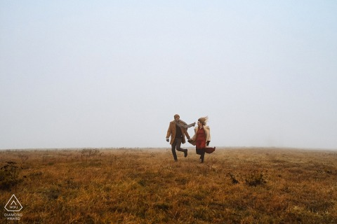 True Love pre wedding Photoshoot at the Vila Ekaterina in Bulgaria of a couple running in an open field in the fog