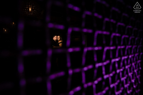 True Love Engagement Picture Session at Sidecar New Braunfels showing a couple behind a purple lit mesh net