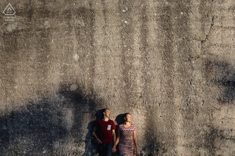 True Love Pre-Wedding Portrait Session in Montpellier capturing a French couple in front of stone wall