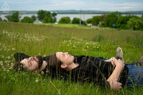 True Love Pre-Wedding Portrait Session in Pavlov showing a Relaxed couple laying in the grass