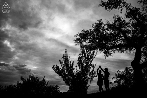 True Love Engagement Picture Session in Pavlov showing a couple doing a Dance move against the cloudy sky