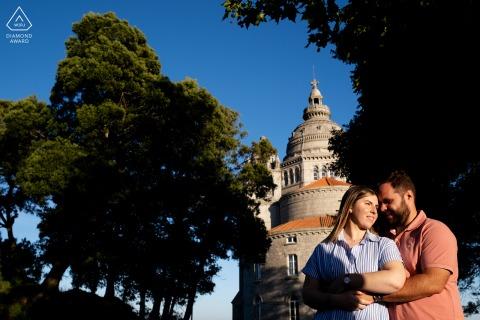 True Love Engagement Portrait Session in Santuário de Santa Luzia displaying a couple with sunset light