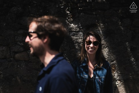 France True Love Engagement Posed Portrait in Noirmoutier capturing a couple playing with light and shadows with sunglasses on