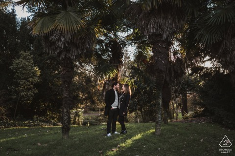 True Love Engagement Picture Session in Rennes showing a couple enjoying the soft light in the garden setting