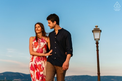 True Love Engagement Portrait Session in Muggia displaying a couple Walking by the sea in Italy