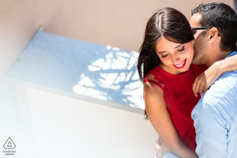 True Love Pre-Wedding Portrait Session in Portopiccolo capturing an IT couple having a Kiss on the neck