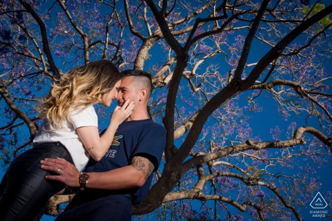 True Love pre wedding Photoshoot in Almeria of a couple embracing under a tree with bright Colors