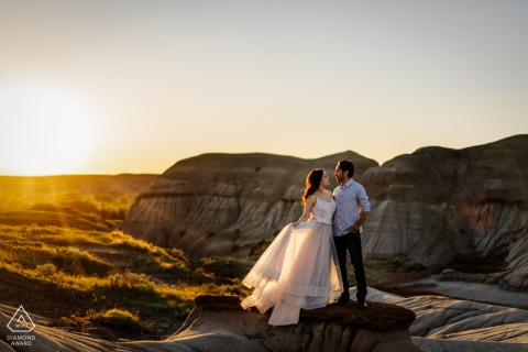 True Love Engagement Portrait Session in Drumheller, AB displaying a couple together under the warm Sunset light
