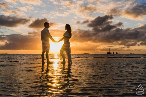 True Love Pre-Wedding Portrait Session in Maceió showing a couple holding hands at sunset in front of the sea
