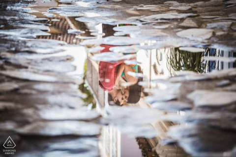 Paraty couple e-session in Rio de Janeiro with water puddle reflections in the urban streets