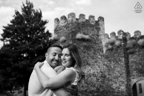 Bragança, Portugal couple e-session hugging at the foot of the castle