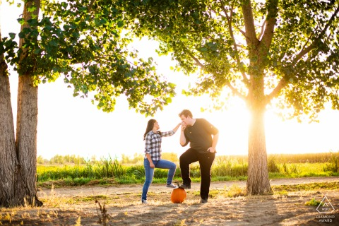 Longmont, Colorado couple e-session of a gentleman giving his fiance' a romantic kiss on her hand