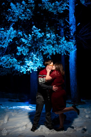 Boulder, Colorado couple e-session, share a smooch in the winter forest