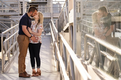 Seaport, Boston couple e-session kissing with reflection in window