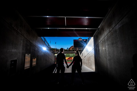 TCF Bank Stadium couple e-session in Minneapolis as they face the football field entrance