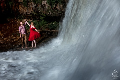 Wisconsin couple e-shoot at Willow River Falls dancing by the waterfall