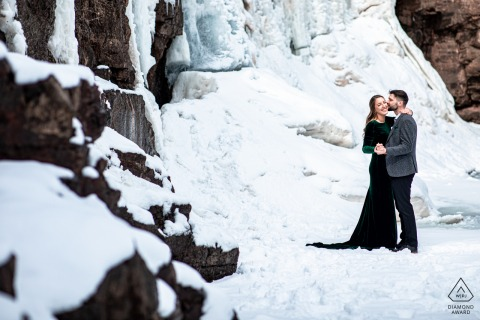 Two Harbors couple e-session in Minnesota at a frozen waterfall