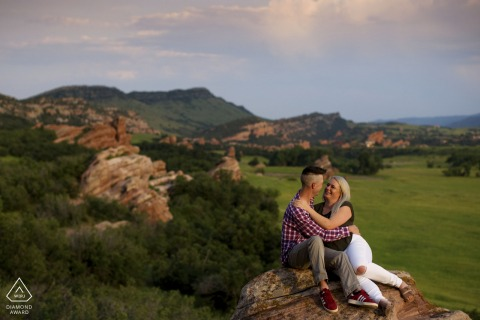 Littleton, CO couple e-session sitting on a natural rock formation