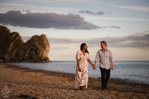 Dorset couple e-session at Durdle Door holding hands by the seaside
