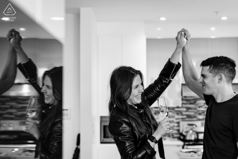 Montreal pre-wedding couple shoot in Quebec celebrating engagement with raised clasped hands