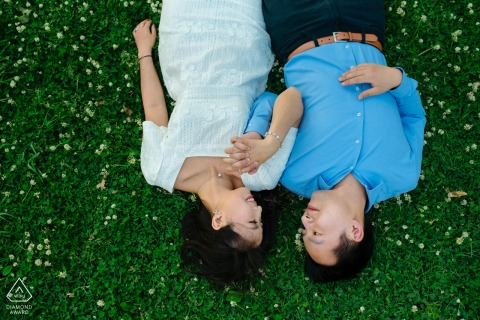 Angrignon Park, Montreal, Quebec couple e-session lying in the grass and holding hands