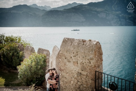 Castle of Malcesine couple engagement shoot at Lake Garda during An intimate pre wedding portrait from the walls
