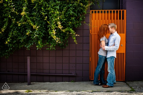 California e-shoot with a Sweet couple sauntered to a colorful door on a San Francisco street