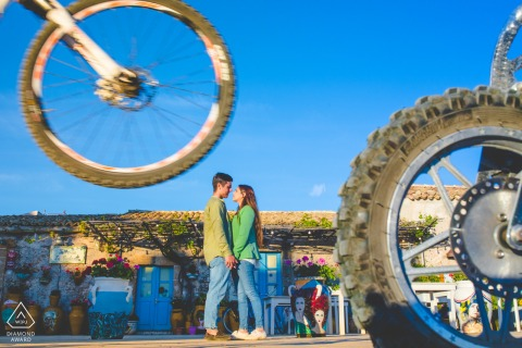 Marzamemi couple e-session with mountain bikes and dirt bikes for a funny image in sicily