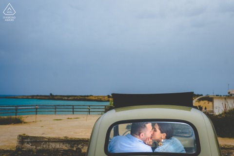 Siracusa couple e-shoot in small car by the water during Spring in Sicily