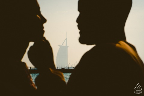 Dubai couple e-shoot with a rim lit soft focus tender touch to the face by the water