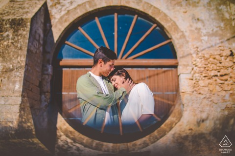 Marzamemi couple e-shoot in a window framing image with love in sicily